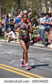 BOSTON - APRIL 16: Genet Getaneh (ethiopia) races up Heartbreak Hill during the Boston Marathon on April 16, 2012 in Boston. Sharon Cherop (Kenya) finished first with a time of 2:30:50.
