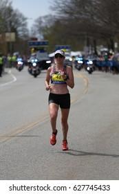 BOSTON - APRIL 17 : Elizabeth Ryan races down heartbreak hill in the Boston Marathon on April 17, 2017 [public race]