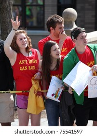 BOSTON - APRIL 18 : Fans cheer on runners during the Boston Marathon April 18, 2011 in Boston. Geoffrey Mutai (Kenya) finished first with a time of 2:03:02.