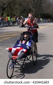 BOSTON - APRIL 18: Team Hoyt  runs in their 33rd marathon up Heartbreak Hill during the Boston Marathon April 18, 2016 in Boston.[public race]