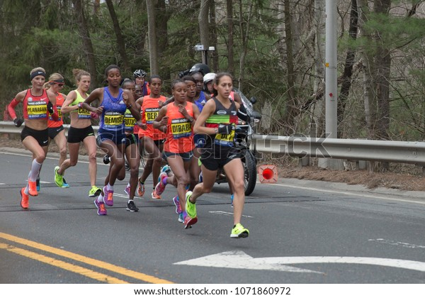 Boston. April 20, 2015. The womens leading group are running past 13 miles in Boston marathon 2015. Womenâ??s winner Caroline Rotich and second place Mare Dibaba are both in the group.