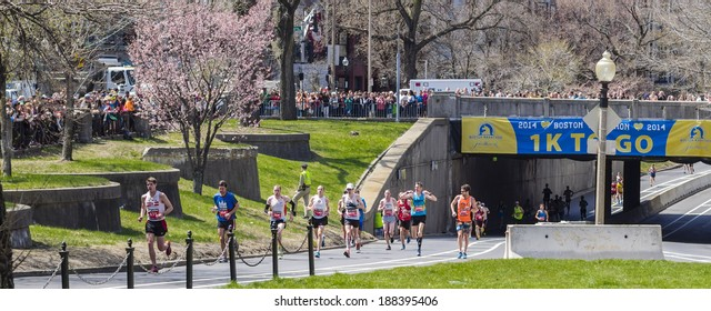 BOSTON - APRIL 21, 2014: Runners in the Boston Marathon pass the 1 kilometer to go line on their way to the finish line, a little over a year after the tragic bombings.