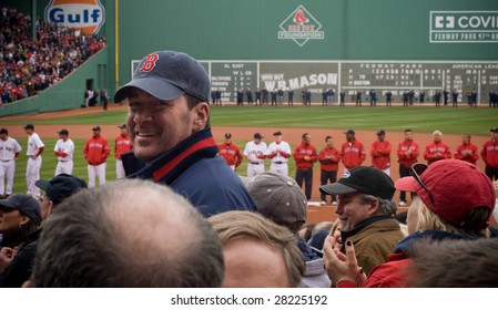 BOSTON - APRIL 7: An excited fan smiles through the crowd at the Boston Red Sox Opening Day at historical Fenway Park April 7, 2009 in Boston, Massachusetts.