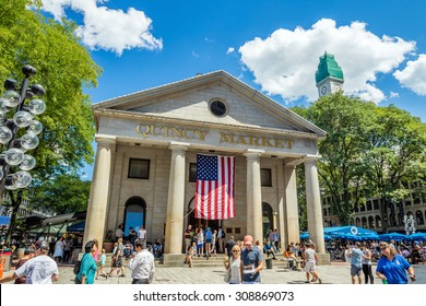 BOSTON - August 13: People visit famous Quincy Market on August 13, 2015 in Boston. Quincy Market dates back to 1825 and is a major tourism destination in Boston.