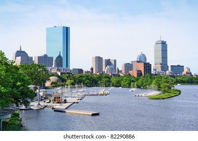 Boston back bay with sailing boat and urban building city skyline in the morning.