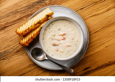 Boston Chowder Soup with Seafood on wooden background copy space