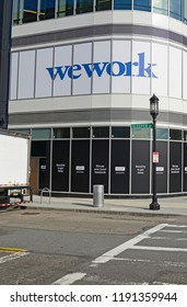 BOSTON CIRCA SEPTEMBER 2018. In the current era of sharing assets, Wework has become increasingly popular as smaller or temporary shared workspace especially as real estate prices rise higher.