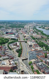 Boston city aerial view with urban buildings and highway.