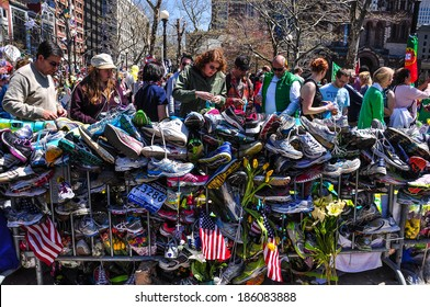 BOSTON CITY - APR 30: Makeshift Memorial for Marathon bombing victims at Copley Square, Boston, Massachusetts on April 30, 2013. Hundreds of people lay flowers, display messages of hope for 4 victims