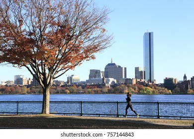 Boston City, Massachusetts - Nov 5, 2013: A jogger running along the Charles River in the downtown area of Boston City, on Nov 5, 2013.