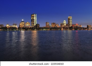 Boston city skyline at dusk with reflection of the skyscrapers over Charles River