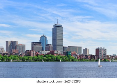 Boston city skyline with Prudential Tower and urban skyscrapers over Charles River with boat.