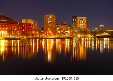 Boston Financial District buildings at night from North Point Park in Cambridge, Massachusetts MA, USA.
