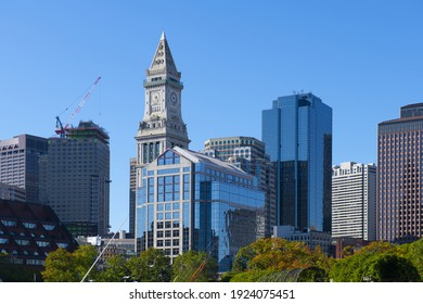 Boston financial district modern city skyline and Custom House at Christopher Columbus Waterfront Park in downtown Boston, Massachusetts MA, USA.