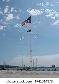 Boston Harbor with American flag and Massachusetts flag on display on the flagpole