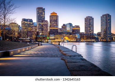 Boston Harbor and Financial District in Boston, Massachusetts, USA at sunset.