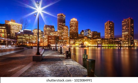 The Boston Harbor and Financial District at sunset in Boston, Massachusetts, USA.