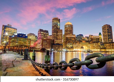 Boston Harbor and Financial District at twilight, Massachusetts in USA.