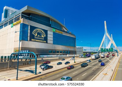 Boston - June 2016, MA, USA: View of TD Garden, Leonard P. Zakim Bunker Hill Bridge and highway with traffic in sunny summer day with clear blue sky