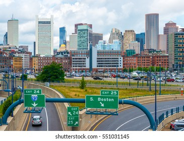 Boston - June 2016, USA: Boston skyline in summer day, view of downtown and highway with cars moving towards financial district of the city