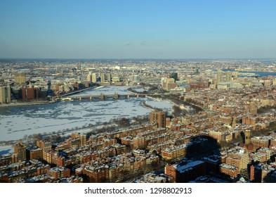 Boston Longfellow Bridge across Charles River and Back Bay apartment in winter, Boston, Massachusetts, USA.