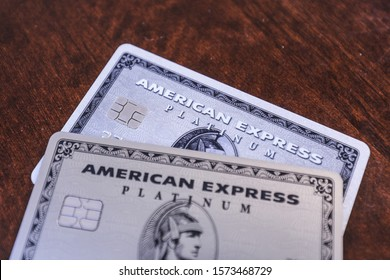 Boston, MA 11/28/2019 — The old plastic version of the American Express Platinum card and the new stainless steel version. The annual fee rose from $450 to $550 when it made the change.