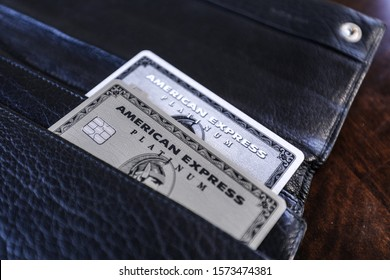 Boston, MA 11/28/2019 — The old plastic American Express Platinum card and the new stainless steel metal version in a black leather Prada wallet.