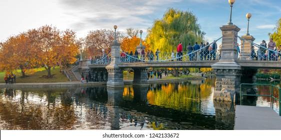 Boston, MA - 11/4/18: Tourists admire the fall foliage in the Public Gardens