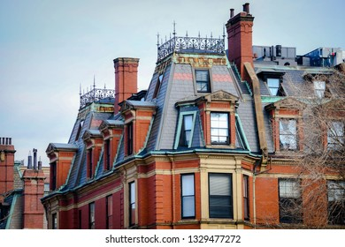 Boston, MA - 1/27/19: Commonwealth Ave is lined with spectacular Victorian brick residences, making the neighborhood one of the city's priciest to call home.
