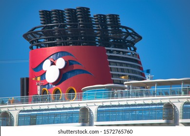 Boston, MA - 5/18/16: The recognizable mouse ears logo marks the funnel of a Disney cruise ship as it departs Boston