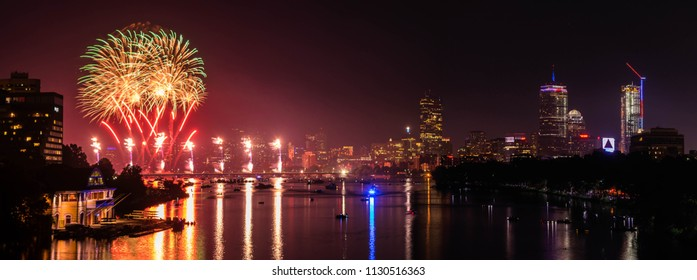 Boston, MA - 7/4/18: The skies over the Charles River Esplanade are illuminated by 4th of July fireworks