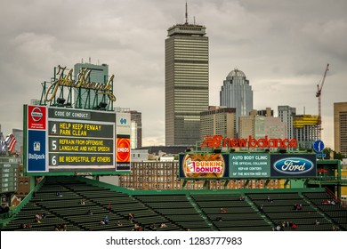 Boston, MA - 9/30/17: The city's skyline looms over the outfield grandstands of Fenway Park