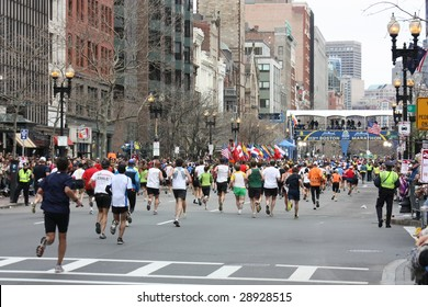 BOSTON, MA - APRIL 20: Runners cross the finish line at the Boston Marathon at the Boston Marathon in action April 20, 2009 in Boston. About 25,000 runners took part in the 113th edition.