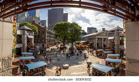 BOSTON, MA - AUGUST 3: Panoramic view of Quincy Market in Boston, MA, USA on a sunny day showcasing its mix of modern and historic architecture with lots of tourists passing by on August 3, 2015.