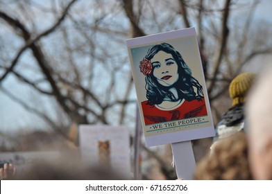 BOSTON, MA - JANUARY 21, 2017 - Women's March: a protester holds up a poster  designed by artist Shepard Fairey. This happened in Boston Common, Boston during the January 2017 Women's march