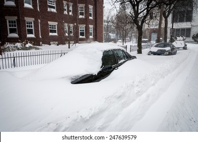 """BOSTON, MA - JANUARY 27, 2015: Nor'easter """"Juno"""" brings heavy snowfall and blizzard conditions, closing roads and burying residents vehicles under feet of snow"""