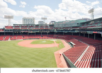 BOSTON, MA, July 4, 2017: Fenway Park, home of the Boston Red Sox, empty and pristine. Boston skyline in the distance.