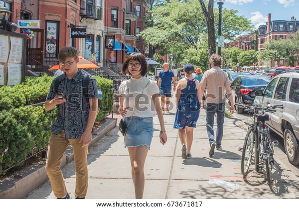 BOSTON, MA, July 4, 2017: Stylish and fashionable young people hang out in the beautiful and historic Back Bay neighborhood, known for it's charming shopping area, in summer.