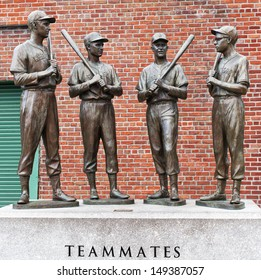 BOSTON, MA - JUNE 4: The statues of Ted Williams, Bobby Doerr, Johnny Pesky, and Dom Dimaggio attract hundreds of baseball fans to the Fenway Park in Boston, MA for souvenir photos on June 4, 2013.