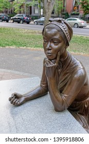 Boston, MA - May 18, 2015: This close up of a bronze statue on Commonwealth Avenue depicts Phillis Wheatley, the first published African-American female poet, and is part of the Women's Memorial.