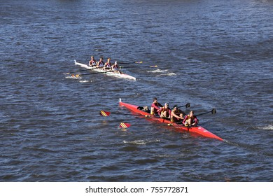 BOSTON, MA - OCTOBER 23, 2016: Illinois(left) and St. John Fisher College Rowing (right) races in the Head of Charles Regatta Men's Collegiate Fours [PUBLIC RACE]