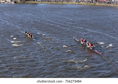 BOSTON, MA - OCTOBER 23, 2016: California Maritime Academy(left) NY Maritime (right)  races in the Head of Charles Regatta Men's Collegiate Fours [PUBLIC RACE]