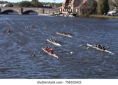 BOSTON, MA - OCTOBER 23, 2016: Many boats race to go under the Western Avenue Bridge First in the Head of Charles Regatta Men's Collegiate Fours [PUBLIC RACE]