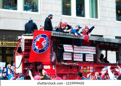 Boston, MA. October 31, 2018.  Boston Red Sox Players tyler thornburg, heath hembree, brian johnson on a bus on Tremont Street celebrating in the Red Sox Championship parade in Boston Massachusetts.