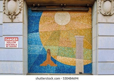 Boston, MA, USA 25 Jul. 2009: Facade Mosaic of Grand Lodge of Masons in Massachusetts Building with greec column, sun and masonic symbols
