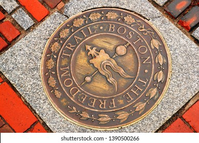 Boston, MA, USA April 25, 2011 A circular marker on the sidewalk directs tourists to stay on the path of the Freedom Trail in Boston