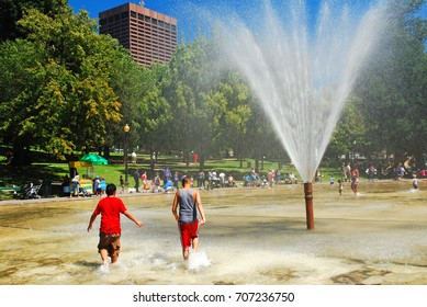 Boston, MA, USA August 10, 2011 Two Teens Cool off during a warm summer day at the Frog Pond in Boston Common, Massachusetts