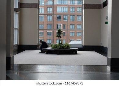 Boston, MA, USA - August 27, 2018 - Amazon Web Services (AWS) Transformation Day 2018 At Hynes Convention Center Man Sitting Alone.