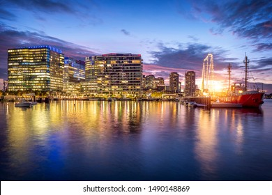 BOSTON, MA, USA - AUGUST 27, 2019: The architecture of Boston in Massachusetts, USA at sunset showcasing its contemporary skyscrapers at Seaport Boulevard.