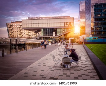 BOSTON, MA, USA - AUGUST 27, 2019: The mix of contemporary and historic architecture of Boston in Massachusetts, USA at sunset at Seaport Boulevard showcasing its Harbor and Financial District.